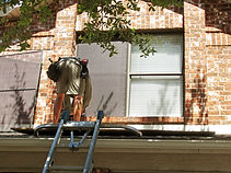 Protect your rain gutters from ladders w/ an arm.