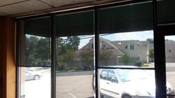 Austin TX roller shades for office windows, 97% Black.