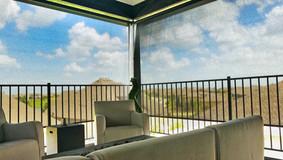 Outdoor patio screens  Austin TX Black sun shade fabric.