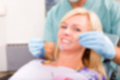 013580407 smiling woman dentist ready ch