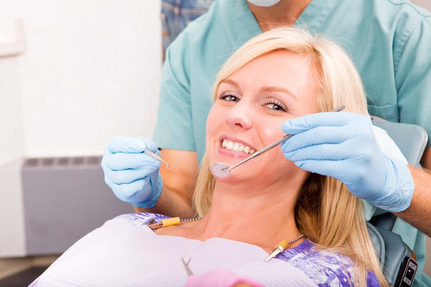 013580407 smiling woman dentist ready ch