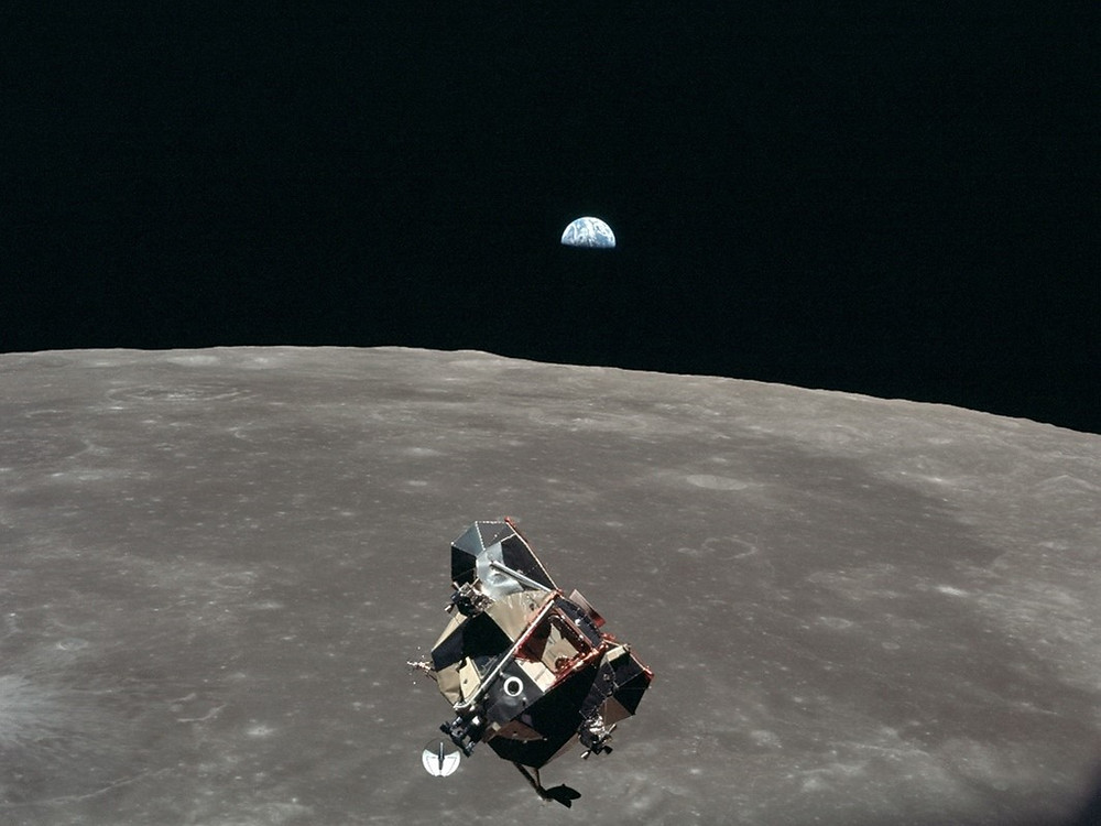 Apollo 1Apollo 11 Lunar Module returning from the surface while Earth is setting over the lunar limb.