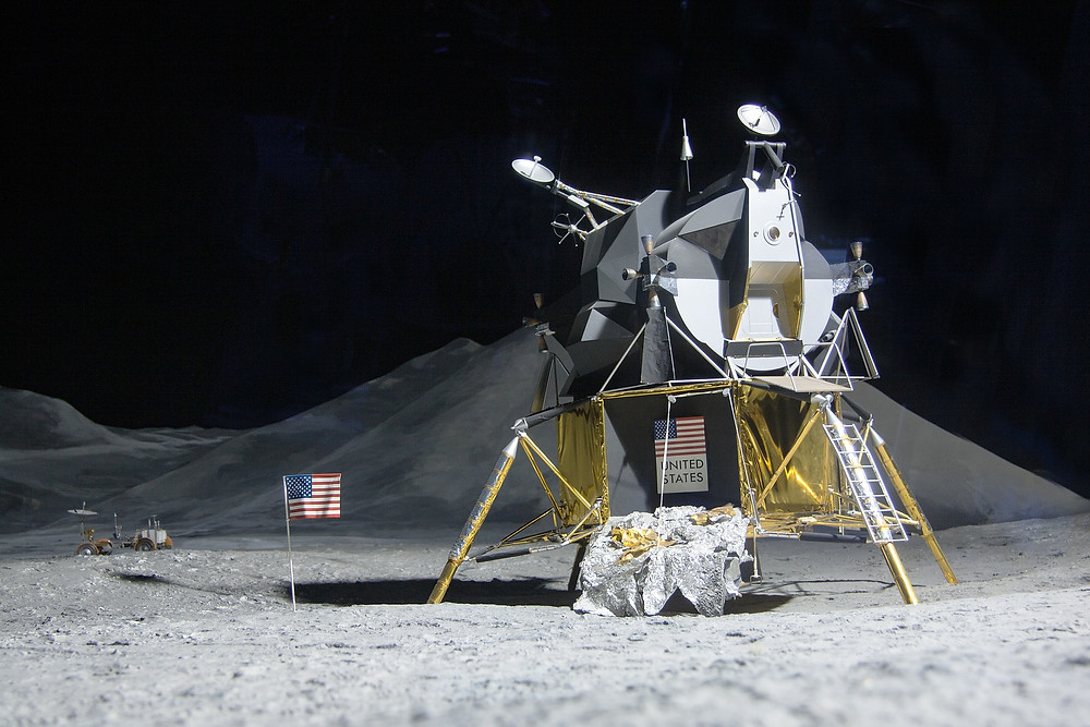 Moon landing of american spacecraft with black background..