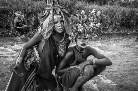 Omo Valley, Ethiopia body painting donga stick fighting flower head dresses cattle camp face painting