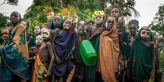 Joan Miller Photography. Omo Valley Ethiopia tribes body painting floral head dresses donga stick fighting villages