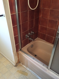BEFORE - red tiled bathroom reno