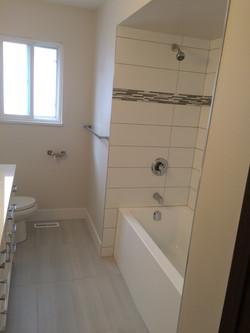 AFTER - red tiled bathroom reno