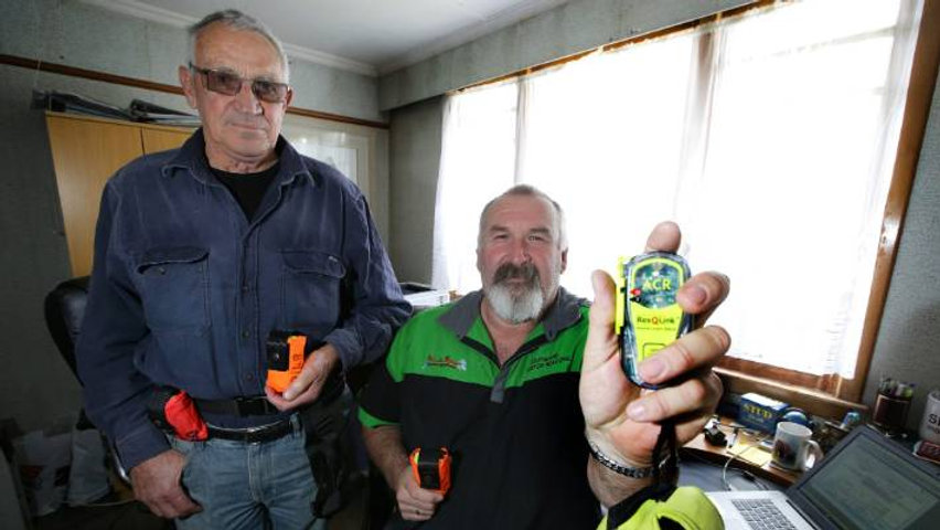 Val McKay, left, and John Munro display the Southland Locator Beacon Charitable Trust's beacons.