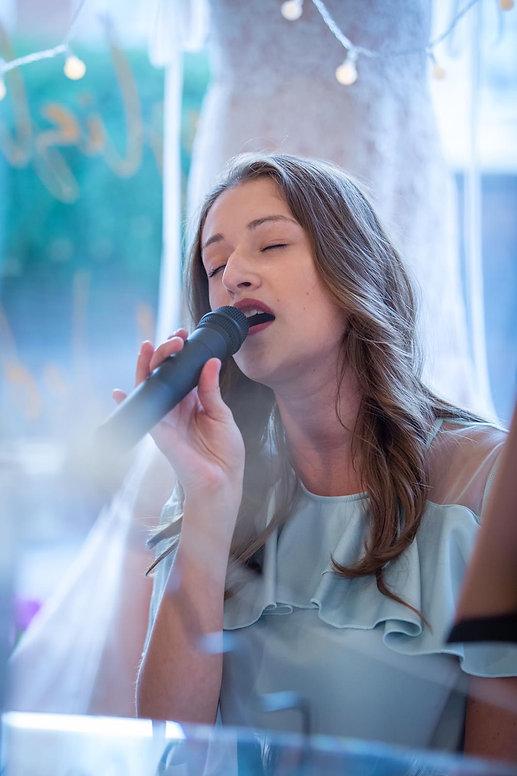 Performing at Maisie Darling.JPG