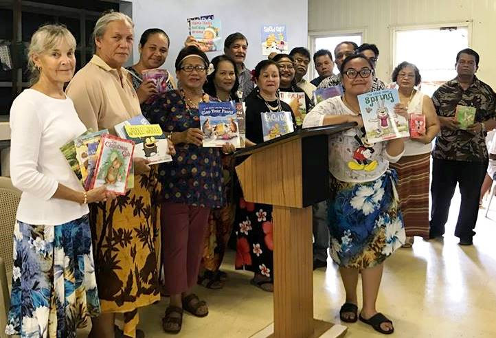 Guam delegates to Pacific Island Bicultural Conference hold books they donated to to Pohnpei Department of Education. Photo by Johanna Salinas