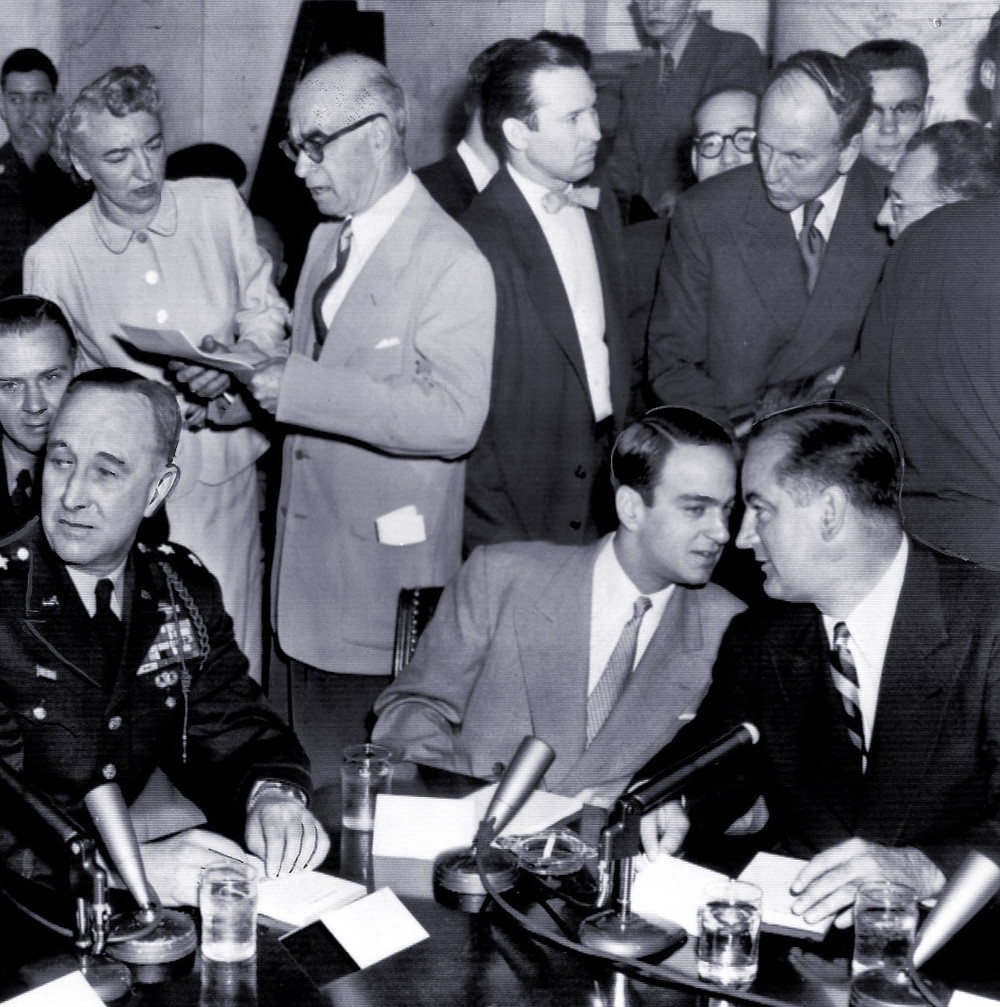 Senator McCarthy gets advice from his attorney, Roy Cohn, at the Army-McCarthy hearings in 1954. Cohn went on to tutor the young Donald Trump