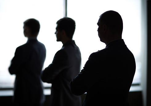 silhouette of three businessmen in the o