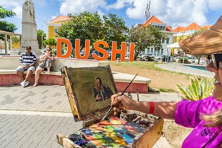 Artist painting plein air in Curacao