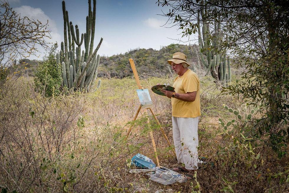 Robin Seur painting en plein ai