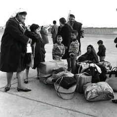 #42 Jewish Refugees wait on a tarmac for a flight out of Algeria to Israel