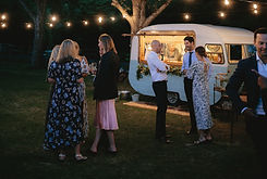 Caravan Bar, Sadie Swoon, at a wedding with guest socialising around her