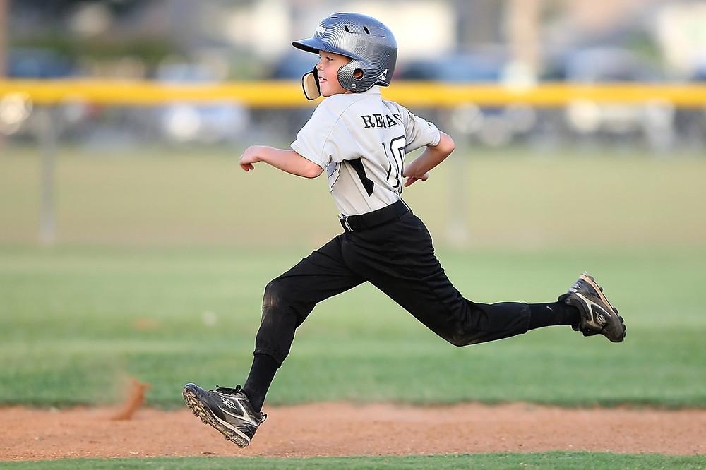 Active boy playing baseball