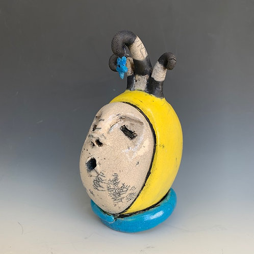 """""""Man in the Moon"""" is a hand-built, raku fired clay sculpture by JoAnne Bedient"""