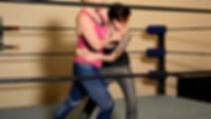 Wrestling students performing a headlock.