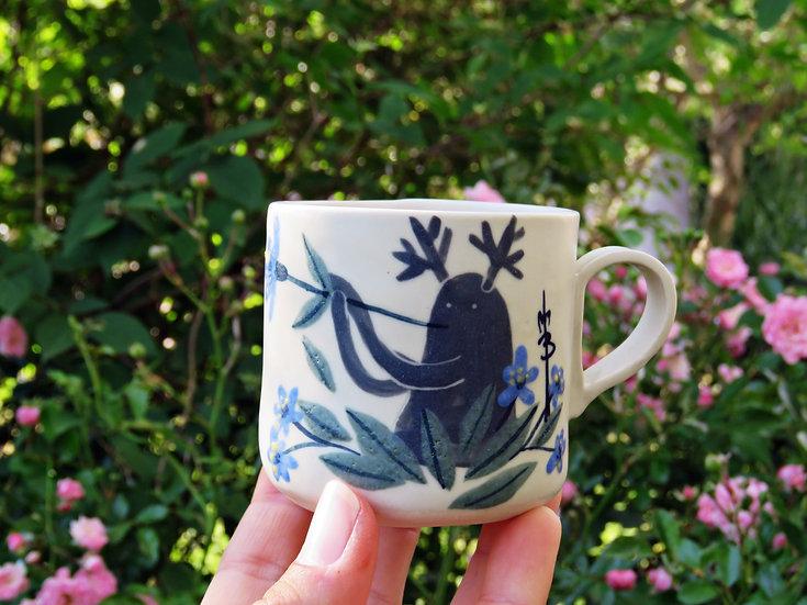 Tasse à café Vagabond souffleur de fleurs bleues