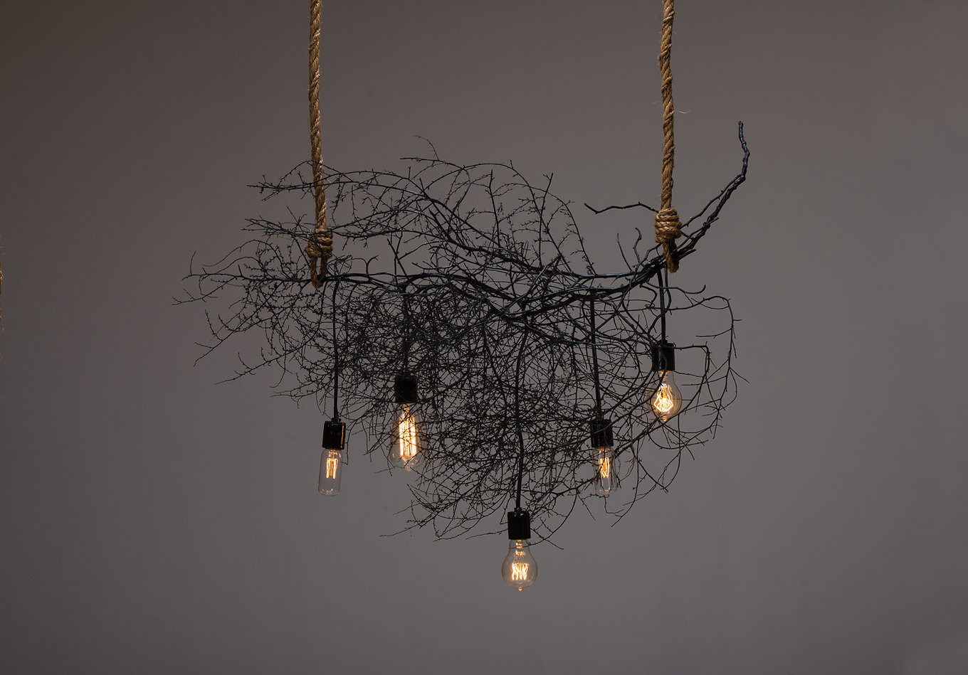 Natural chandeliers made with sculpted and preserved tumbleweeds by Same Tree. Modern designed lighting with a natural touch.