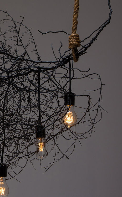 Modern designed lighting with a natural touch. Custom made with a sculpted tumbleweed as it's frame.