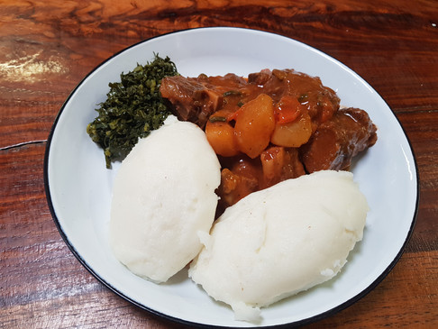 Traditional Meals at the Cafe... Come and try our delicious Pap & Beef Stew with green vegetables.