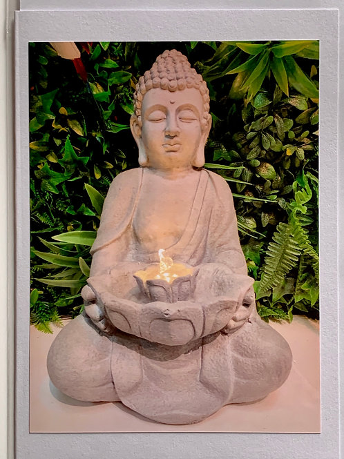 Buddha with lit fountain