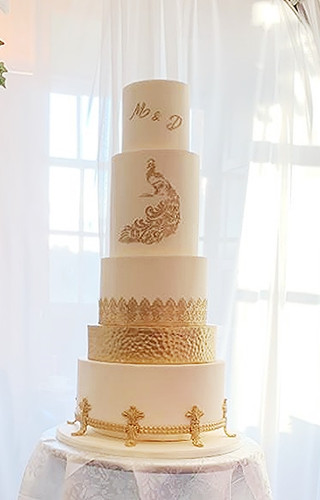 Gold and Ivory Peacock Wedding Cake