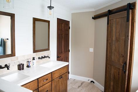 bathroom vanity and rustic barndoor