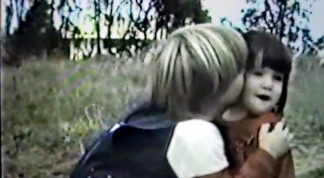 gal kissing his sis in the fields.mp4