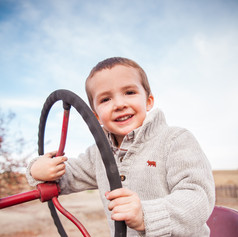 Cutie on a tractor
