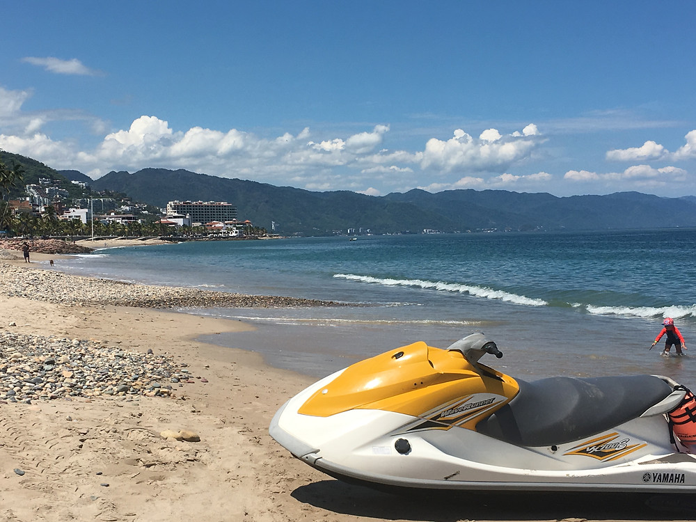 A jet-ski sits on an empty beach in Puerto Vallarta, Mexico.