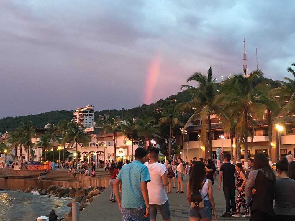 Tourists and families explore the Puerto Vallarta malecon.