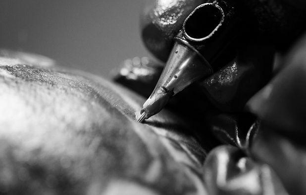 A professional tattoo artist introduces
