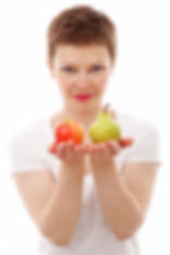 canva-woman-holding-red-apple-and-green-
