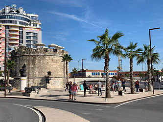 This is a picture of a Touristic group waiting for the bus near by the Venetian Tower in the center of Durres city Enjoy your Trip with EnjoyTravelGuide