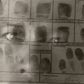 Self-Portrait with Marcus Garvey's Prison Docket