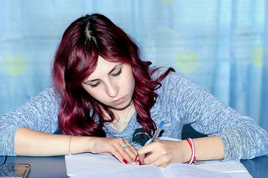 female student with red hair studying