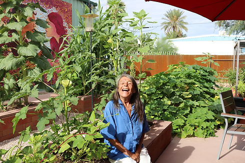 smiling woman at a community garden