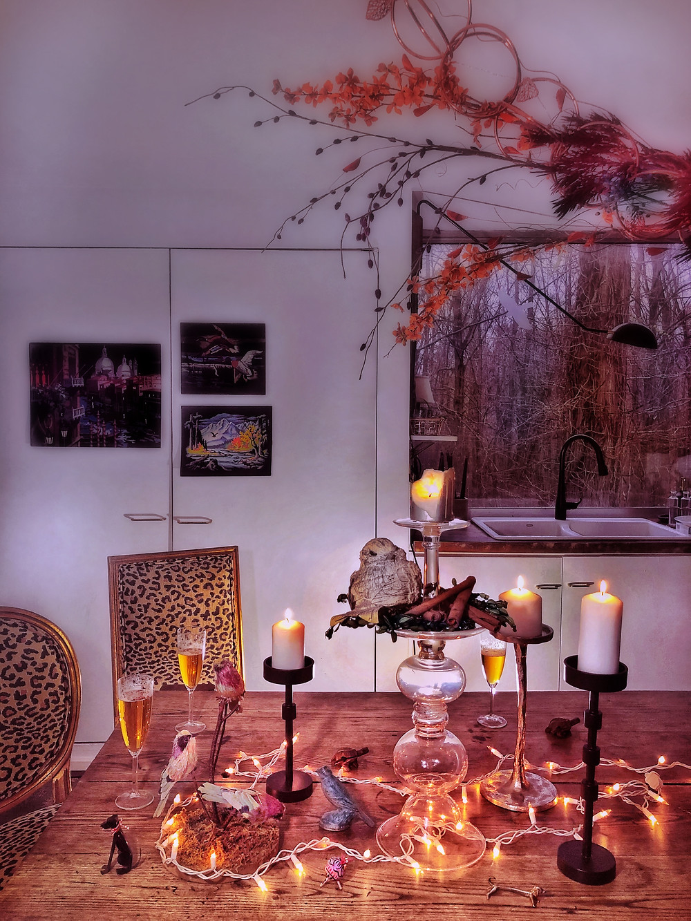 String lights, candles, animal figurines on the dining table