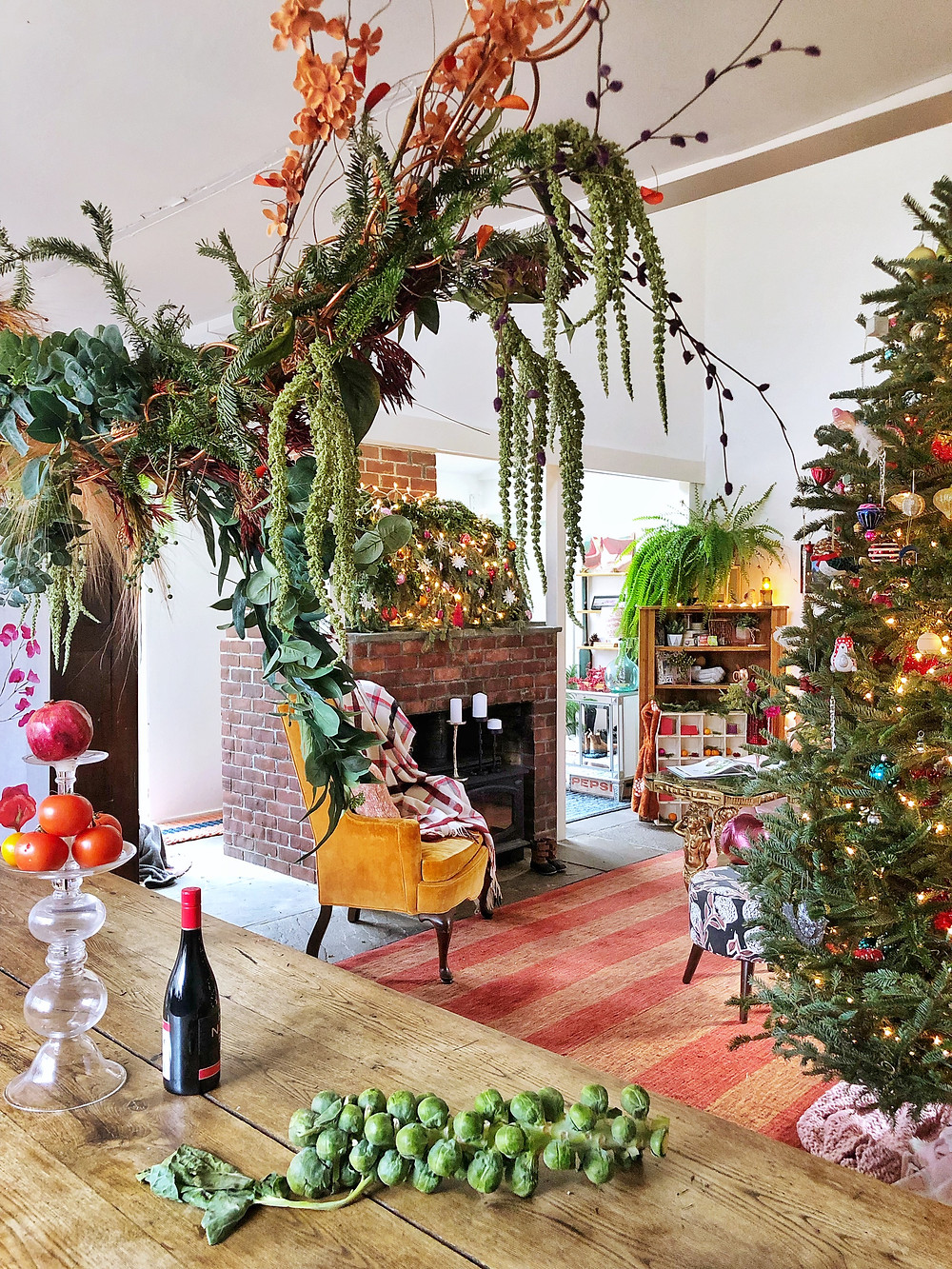 Interior Christmas jungle with weeping above head centerpiece.