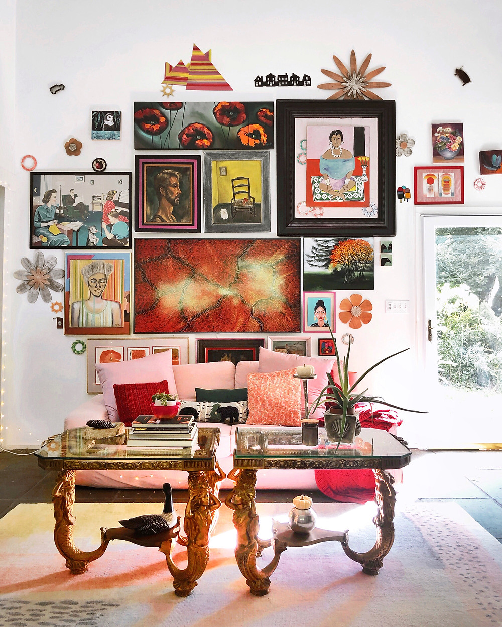 Whimsical gallery wall, mermaid tables, pink and red decor