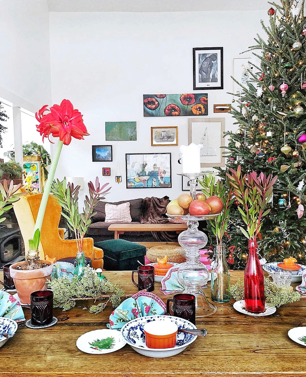 Christmas tree, gallery wall and dining table set up for holiday lunch