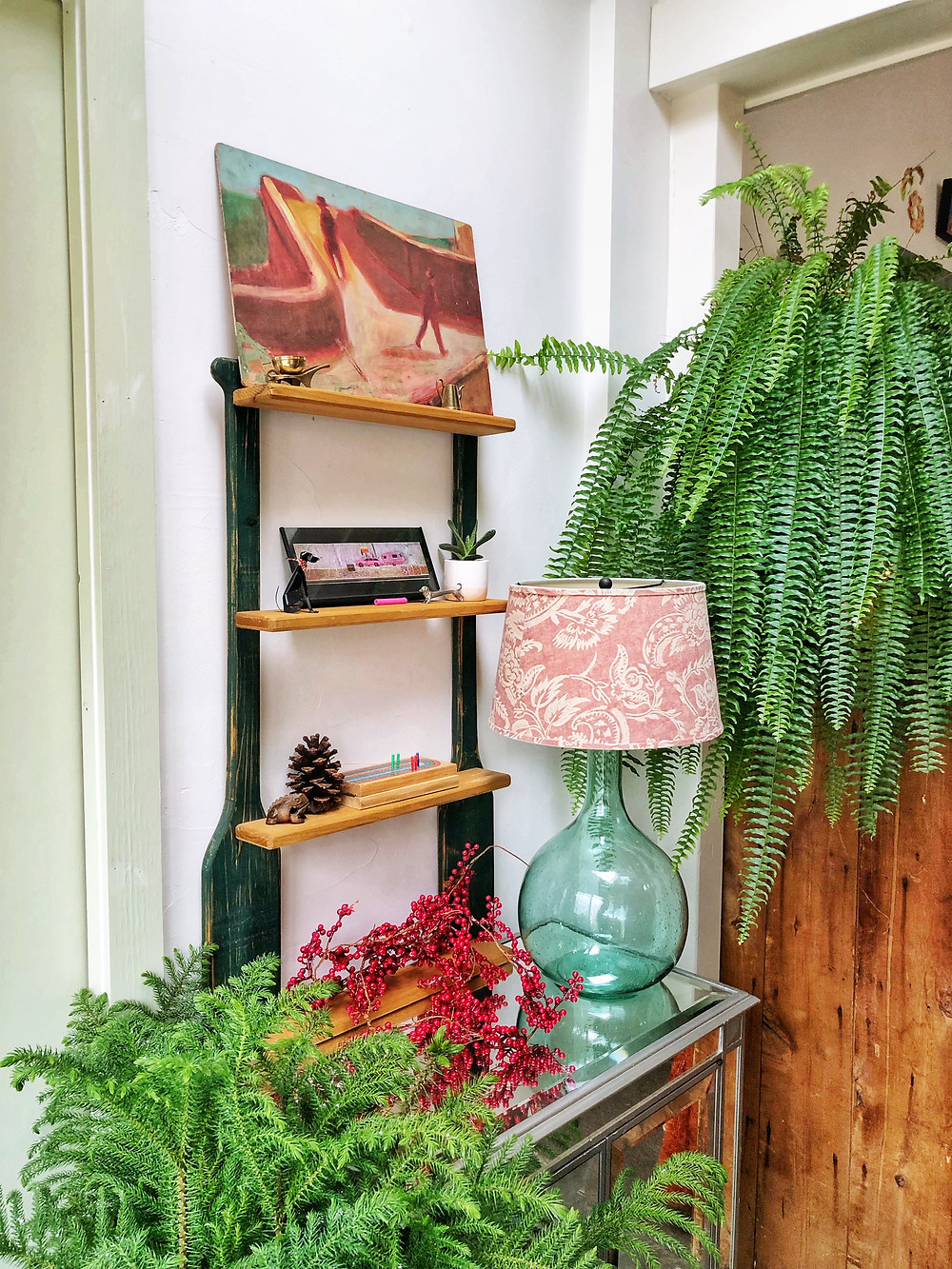front entry with fern and nordic pine