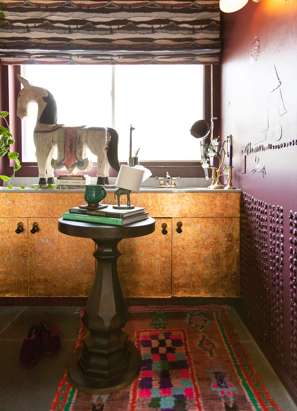 side table in bathroom, copper leaf cabinets, vintage pieces for an eclectic look