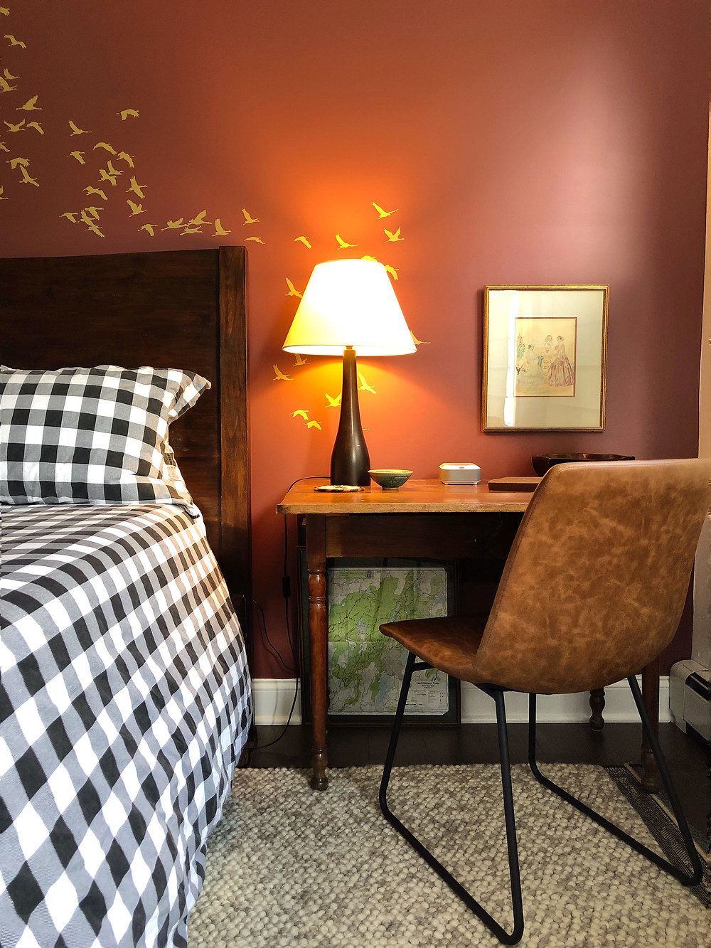 Buffalo check bedding with lamp lit bedside table/ writing desk