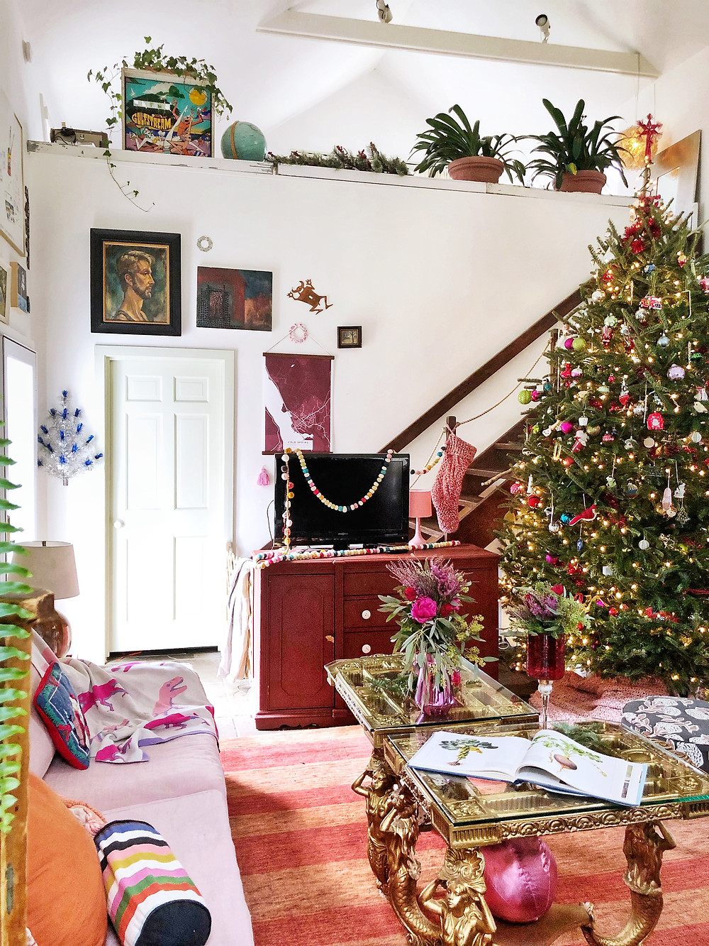 Christmas tree in loft home with gallery wall