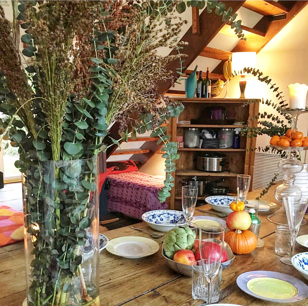 Holiday table setting with mini pumpkins