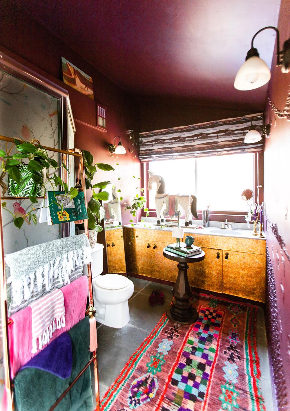 Moroccan rug, copper bathroom cabinets, brinjal by farrow and ball, cozy bathroom